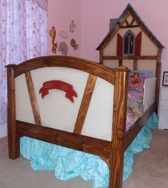 This is a twin-size bed I built for my grand-daughter. It is done in the Tudor style, and the window features a night sky (with blue LED night light), and Tinkerbell peeking through.
